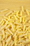 Macaroni on long spaghetti. Stock Image