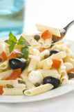 Macaroni mozzarella olives capers tomatoes salad Stock Photos