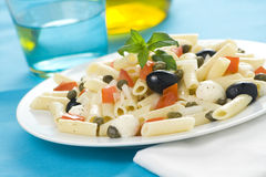 Macaroni mozzarella olives capers tomatoes salad Stock Photography