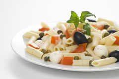 Macaroni mozzarella olives capers tomatoes salad Royalty Free Stock Image