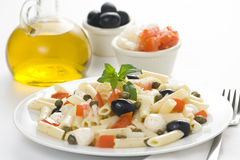 Macaroni mozzarella olives capers tomatoes salad Stock Photo
