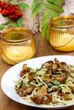 Macaroni with mushrooms Stock Images