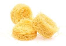 Macaroni nest. On a white background Stock Image