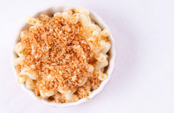 Macaroni noodles and cheese with toasted breadcrumb topping. On a white background Royalty Free Stock Photos