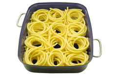 Macaroni noodles in a roaster on white Stock Images