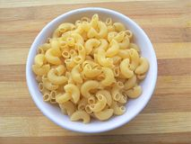 Macaroni pasta in bowl Royalty Free Stock Photography