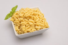 Macaroni Pasta. Cooked macaroni in bowl on white background Royalty Free Stock Photos