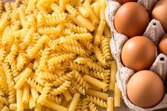 Macaroni Pasta and fresh eggs Royalty Free Stock Photos