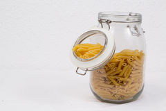 Macaroni in a glass jar stock images