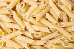 Macaroni pasta making a background pattern Stock Image