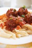 Macaroni pasta with meatballs. Italian macaroni pasta with meatballs and tomato sauce Royalty Free Stock Images
