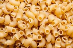 Macaroni or pasta texture background. Macro, close-up view Stock Photo