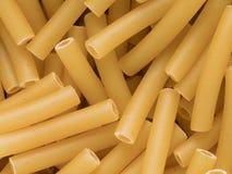 Macaroni pasta tubes food background Royalty Free Stock Images