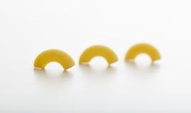 Macaroni pasta on white background. Raw macaroni on white background Royalty Free Stock Image