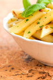 Macaroni with pesto close up Stock Photography