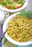 Macaroni with Pesto Sauce and Rosemary #1. Macaroni with pesto sauce, rosemary and salad Stock Images