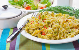 Macaroni with Pesto Sauce and Rosemary #2. Macaroni with pesto sauce, rosemary and salad Royalty Free Stock Photography