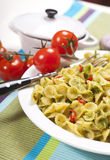 Macaroni with Pesto Sauce and Tomato #1. Macaroni with pesto sauce and tomato Stock Photography