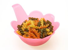 Macaroni in a plastic bowl Stock Images