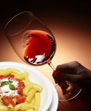 Macaroni and red wine Stock Images