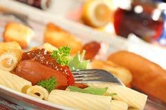 Macaroni with sausage. Royalty Free Stock Photo