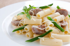 Macaroni with sausage and green beans Stock Images