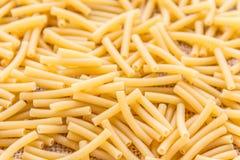 Macaroni. Scattered Macaroni Pasta -  Macaroni / Maccheroni Pasta Background Stock Images