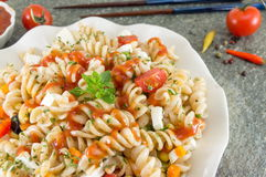 Macaroni served with cheese vegetables and parsley Royalty Free Stock Images