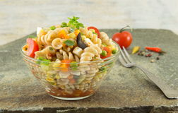Macaroni served with cheese vegetables and parsley Stock Image