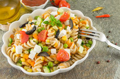 Macaroni served with cheese vegetables and parsley Royalty Free Stock Photos
