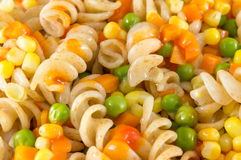 Macaroni served with vegetables close up Stock Photos