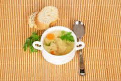 Macaroni soup, bread slices, spoon and parsley Stock Photography