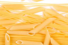 Macaroni of spaghetti feathers on a white background. Top view royalty free stock image