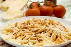 Macaroni with tomato. Close up of a typical Italian dish with macaroni, tomato and cheese Royalty Free Stock Photography