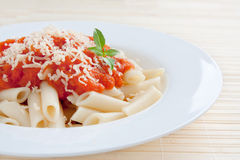 Macaroni with tomato and cheese Stock Image