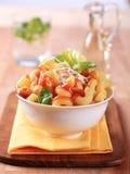 Macaroni with tomato sauce. Bowl of macaroni with tomato sauce and cheese Royalty Free Stock Image
