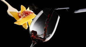 Macaroni with tomato sauce and glass with red wine Stock Images