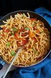 Macaroni in tomato sauce Stock Images