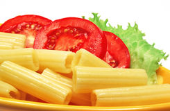 Macaroni and tomatoes Royalty Free Stock Photography