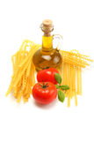 Macaroni, tomatoes, basil and oil. Spaghetti ingredient royalty free stock photos