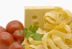 Macaroni, tomatoes, cheese and greens Stock Photos