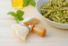 Macaroni with typical italian sauce. Of crushed basil, cheese and oil Royalty Free Stock Image