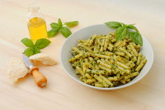 Macaroni with typical italian sauce of basil Royalty Free Stock Images