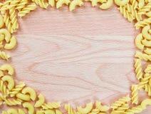 Macaroni on wooden background Royalty Free Stock Photos