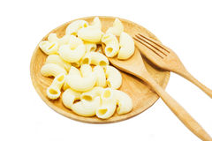 Macaroni on the wooden dish Stock Images