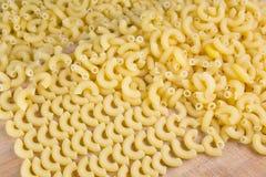 Macaroni. Yellow italian macaroni as background Stock Images