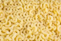 Macaroni. Yellow italian macaroni as background Royalty Free Stock Photography