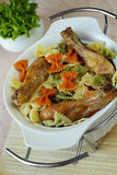 Macaronis with the fried chickens decorated by vegetables Stock Image