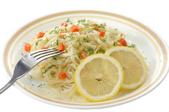 Macaronis with the vegetables. Plate with the macaronis and the vegetables by the closeup Royalty Free Stock Photos