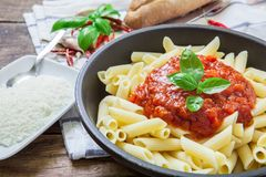 Italian pasta dish. Macaronni with bolognese sauce and basil with grilled cheese Royalty Free Stock Photo